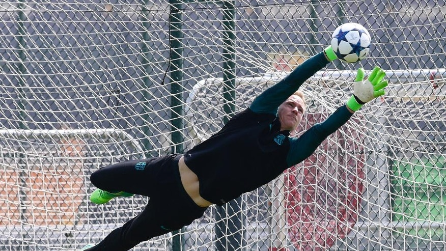 FC Barcelona's goalkeeper Marc-Andre ter Stegen saves a ball during a training session at the Sports Center FC Barcelona Joan Gamper in Sant Joan Despi, Spain, Tuesday, April 18, 2017.  FC Barcelona will play against Juventus in a Champions League quarterfinal, second-leg soccer match on Wednesday .(AP Photo/Manu Fernandez)