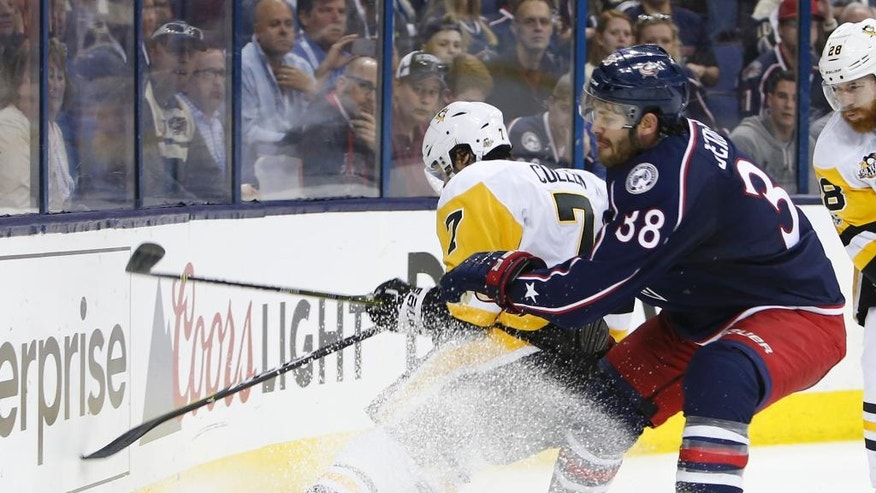 Columbus Blue Jackets' Boone Jenner, right, checks Pittsburgh Penguins' Matt Cullen during the second period of Game 4 of an NHL first-round hockey playoff series Tuesday, April 18, 2017, in Columbus, Ohio. (AP Photo/Jay LaPrete)