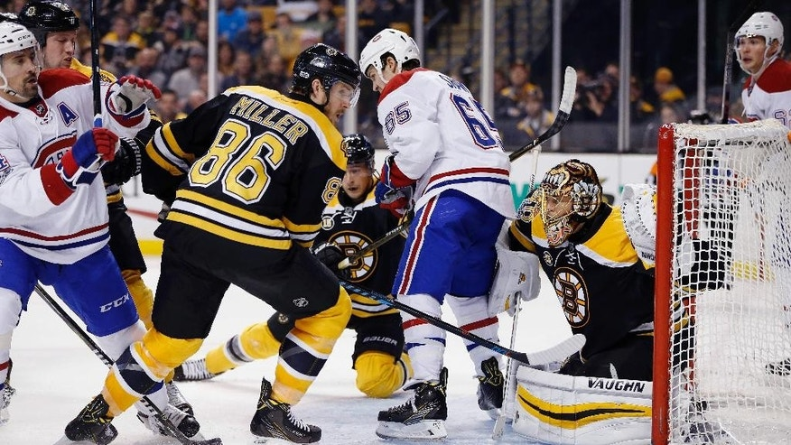FILE - In this Feb. 12, 2017, file photo, Boston Bruins goalie Tuukka Rask, right, tries to looks around the screen from Montreal Canadiens' Andrew Shaw (65) during the third period of an NHL hockey game in Boston. Teams are using the art of the screen for an edge this postseason. (AP Photo/Michael Dwyer, FIle)