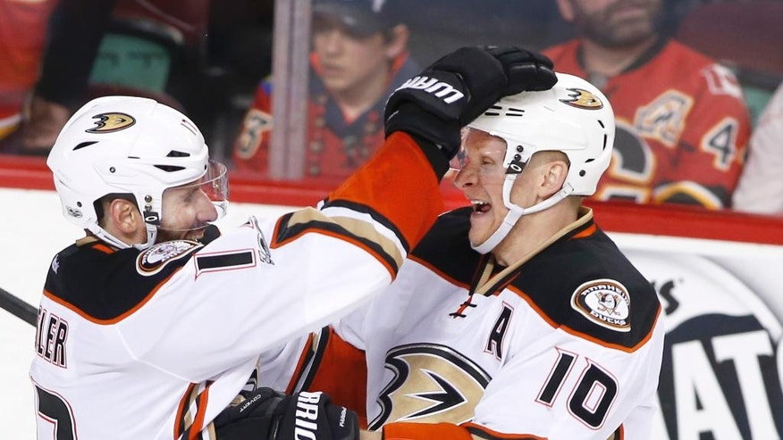 Anaheim Ducks' Corey Perry, right, celebrates his goal against the Calgary Flames with Ryan Kesler during overtime in Game 3 of a first-round NHL hockey Stanley Cup playoff series in Calgary, Alberta, Monday, April 17, 2017. (Larry MacDougal/The Canadian Press via AP)