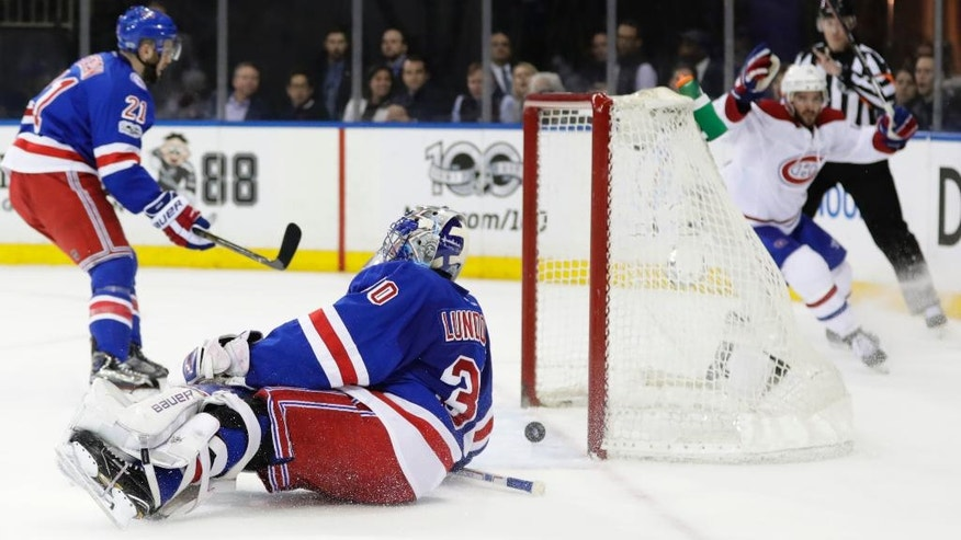 New York Rangers goalie Henrik Lundqvist (30), of Sweden, reacts as Montreal Canadiens' Torrey Mitchell, right, celebrates after scoring a goal during the first period of an NHL hockey game in Game 4 of an NHL hockey first-round playoff series Tuesday, April 18, 2017, in New York. (AP Photo/Frank Franklin II)
