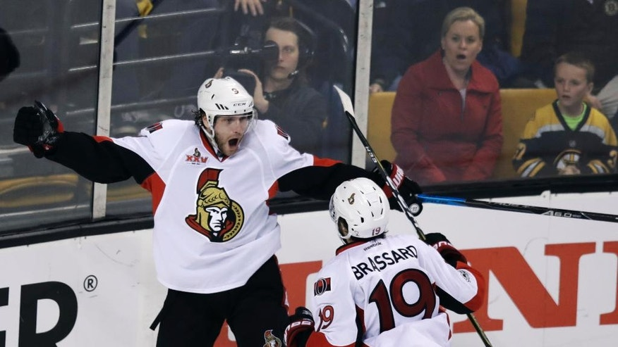 Ottawa Senators right wing Bobby Ryan, left, is congratulated by Derick Brassard after his goal during the third period of Game 4 of a first-round NHL hockey playoff series in Boston, Wednesday, April 19, 2017. (AP Photo/Charles Krupa)
