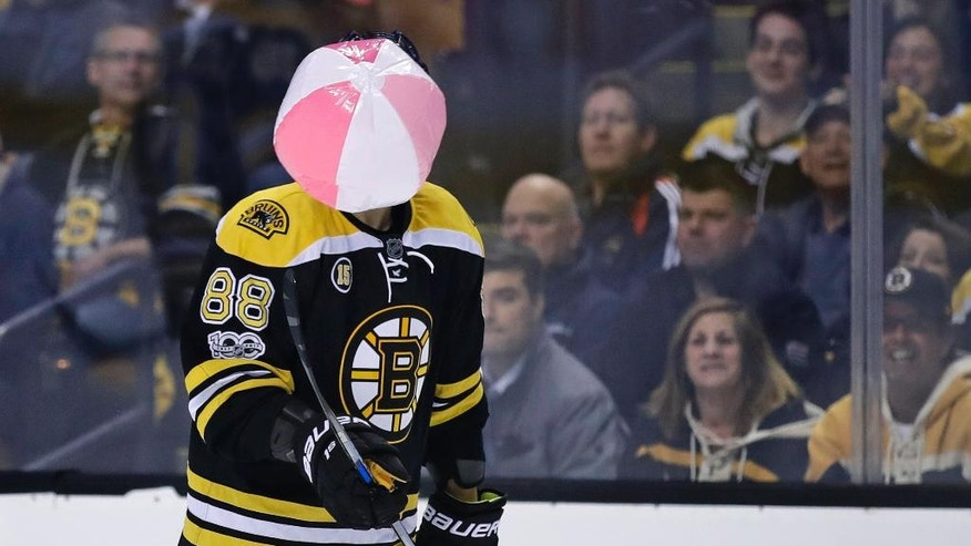Boston Bruins left wing David Pastrnak juggles a beach ball which landed on the ice during the second period against the Ottawa Senators in Game 4 of a first-round NHL hockey playoff series in Boston, Wednesday, April 19, 2017. (AP Photo/Charles Krupa)
