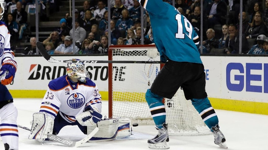 San Jose Sharks' Joe Thornton, right, celebrates as Edmonton Oilers goalie Cam Talbot, left, is beaten for a goal on a shot from San Jose Sharks' Logan Couture, not seen, during the first period in Game 4 of a first-round NHL hockey playoff series Tuesday, April 18, 2017, in San Jose, Calif. (AP Photo/Marcio Jose Sanchez)