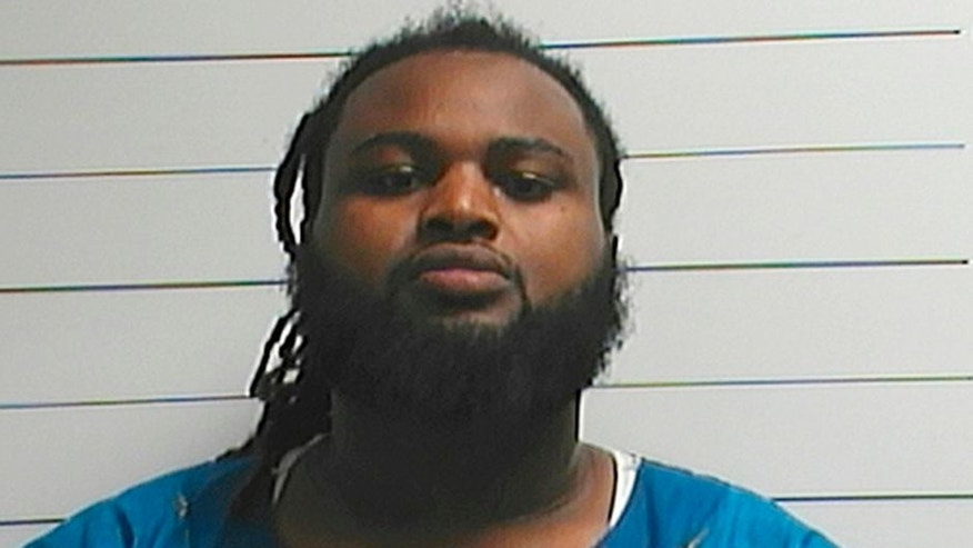 FILE - This April 10, 2016, file photo provided by the Orleans Parish Sheriff's Office shows Cardell Hayes. Hayes, who killed former New Orleans Saints star Will Smith in an argument following a traffic crash, avoided a mandatory life sentence when a jury convicted him of manslaughter instead of second-degree murder. But Hayes may still be locked away for a very long time if prosecutors get their way at a sentencing hearing Wednesday, April 19, 2017. (Orleans Parish Sheriff's Office via AP, File)