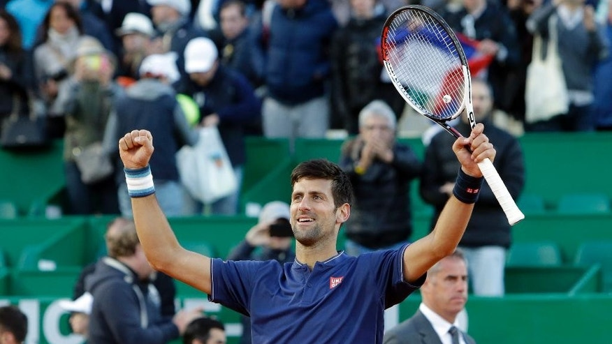 Serbia's Novak Djokovic reacts after defeating Spain's Pablo Carreno Busta, during their third round match of the Monte Carlo Tennis Masters tournament in Monaco, Thursday, April 20, 2017. (AP Photo/Claude Paris)
