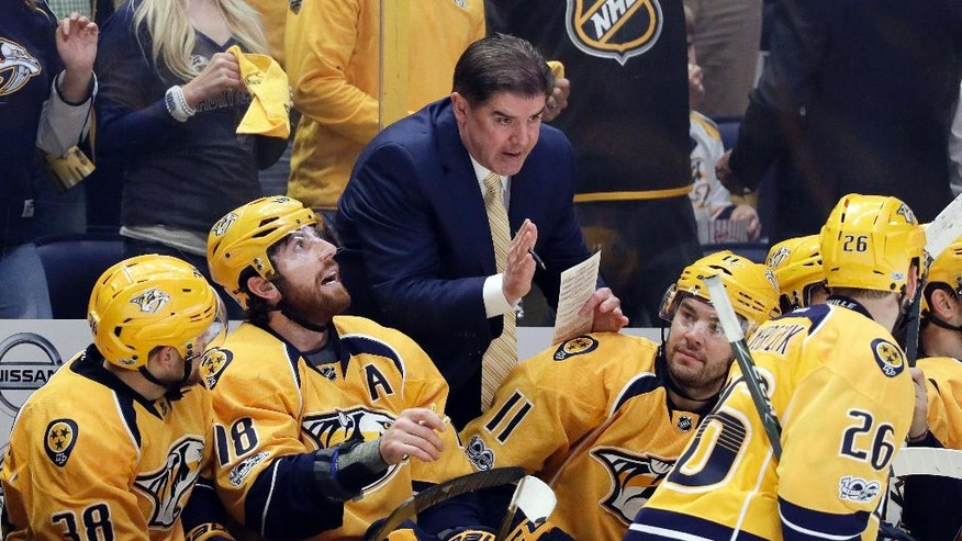 Nashville Predators coach Peter Laviolette talks to his players during the third period in Game 4 of a first-round NHL hockey playoff series against the Chicago Blackhawks on Thursday, April 20, 2017, in Nashville, Tenn. (AP Photo/Mark Humphrey)