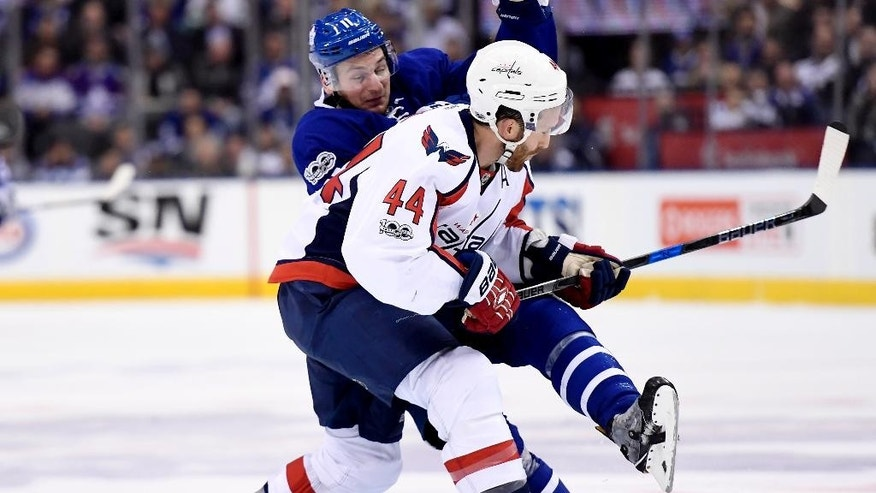 Washington Capitals defenseman Brooks Orpik (44) checks Toronto Maple Leafs centre Zach Hyman (11) at the blue line during second period NHL hockey round one playoff action in Toronto on Wednesday, April 19, 2017. (Frank Gunn/The Canadian Press via AP)
