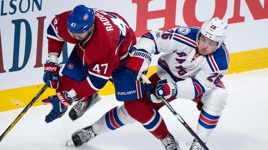 Montreal Canadiens right wing Alexander Radulov (47) and New York Rangers left wing Jimmy Vesey (26) vie for control for the puck during the second period of Game 5 of a first-round NHL hockey Stanley Cup playoff series, Thursday, April 20, 2017, in Montreal. (Paul Chiasson/The Canadian Press via AP)