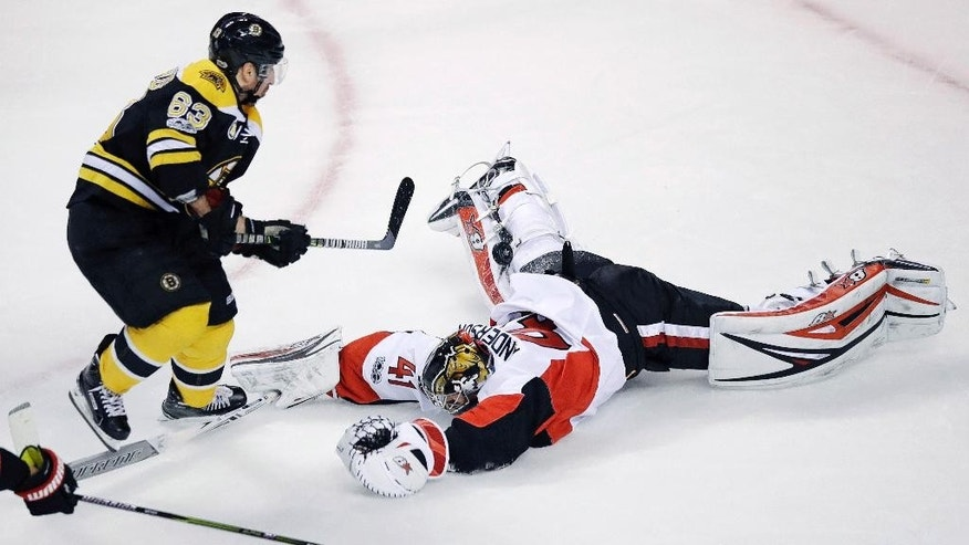 Ottawa Senators goalie Craig Anderson (41) makes a diving save on a shot by Boston Bruins left wing Brad Marchand (63) during the first period of Game 4 of a first-round NHL hockey playoff series in Boston, Wednesday, April 19, 2017. (AP Photo/Charles Krupa)