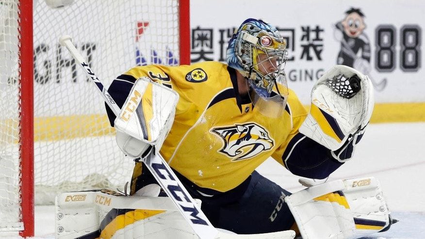 Nashville Predators goalie Pekka Rinne, of Finland, gloves a Chicago Blackhawks shot during the third period in Game 4 of a first-round NHL hockey playoff series Thursday, April 20, 2017, in Nashville, Tenn. Rinne stopped 30 shots as the Predators won 4-1, sweeping the series. (AP Photo/Mark Humphrey)