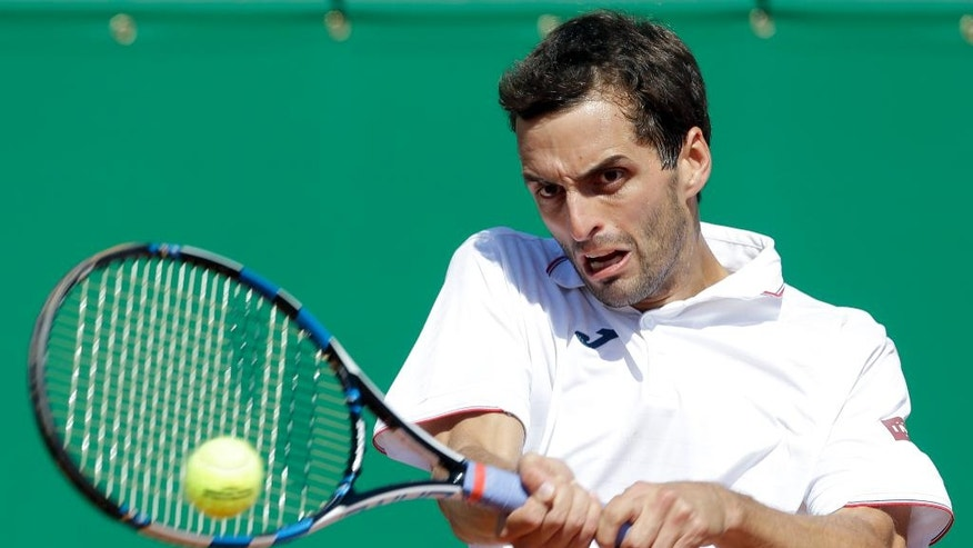 Spain's Albert Ramos-Vinolas returns the ball to Croatia's Marin Cilic during their quarterfinal match of the Monte Carlo Tennis Masters tournament in Monaco, Friday, April, 21, 2017. (AP Photo/Claude Paris)