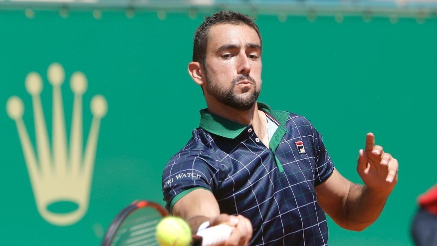 Croatia's Marin Cilic returns the ball to Spain's Albert Ramos-Vinolas, during their quarterfinal match of the Monte Carlo Tennis Masters tournament in Monaco, Friday, April, 21, 2017. (AP Photo/Claude Paris)
