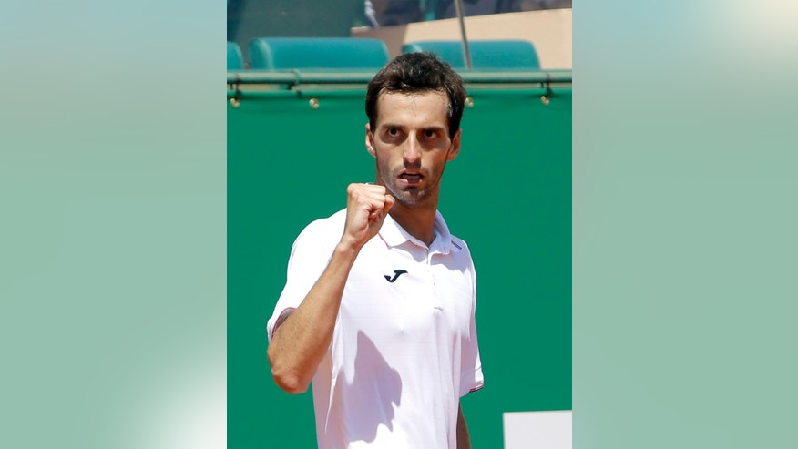 Spain's Albert Ramos-Vinolas celebrates winning a point against Croatia's Marin Cilic during their quarterfinal match of the Monte Carlo Tennis Masters tournament in Monaco, Friday, April, 21, 2017. (AP Photo/Claude Paris)