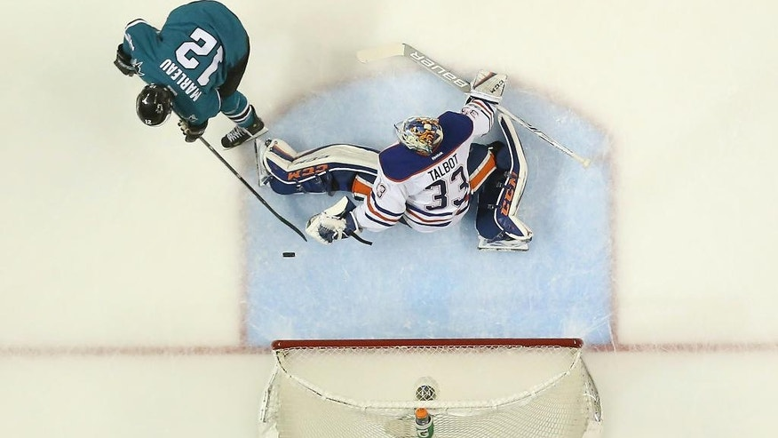 Edmonton Oilers goalie Cam Talbot (33) blocks a goal attempt by San Jose Sharks center Patrick Marleau (12) during the second period in Game 6 of a first-round NHL hockey playoff series Saturday, April 22, 2017, in San Jose, Calif. (AP Photo/Tony Avelar)