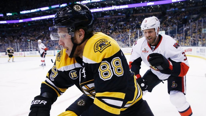 Boston Bruins' David Pastrnak (88), of the Czech Republic, and Ottawa Senators' Marc Methot (3) battle along the boards during the second period in Game 6 of a first-round NHL hockey Stanley Cup playoff series, Sunday, April 23, 2017, in Boston. (AP Photo/Michael Dwyer)