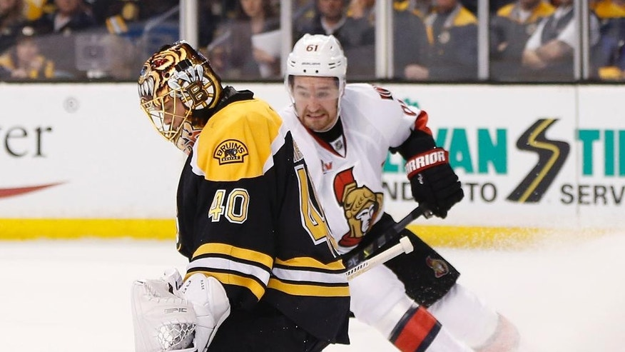 Boston Bruins' Tuukka Rask (40), of Finland, blocks a shot by Ottawa Senators' Mark Stone (61) during the first period in game six of a first-round NHL hockey Stanley Cup playoff series, Sunday, April 23, 2017, in Boston. (AP Photo/Michael Dwyer)