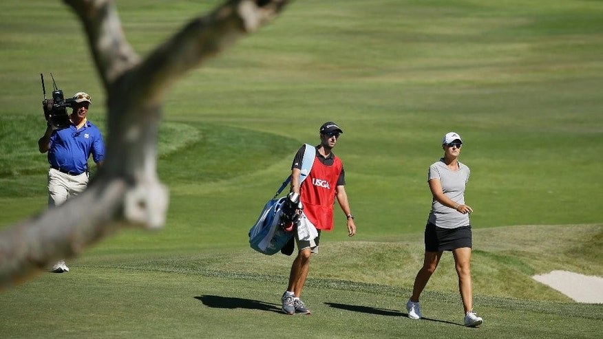 FILE - In this July 10, 2016, file photo, Anna Nordqvist, of Sweden, walks to the green after hitting out of a bunker on the second playoff hole of the U.S. Women's Open golf tournament at CordeValle, in San Martin, Calif.  Nordqvist was penalized for clipping sand during a bunker shot in the final round. Golf's ruling bodies issued a new guideline Tuesday that limits the use of video evidence in determining rules violations. (AP Photo/Eric Risberg, File)