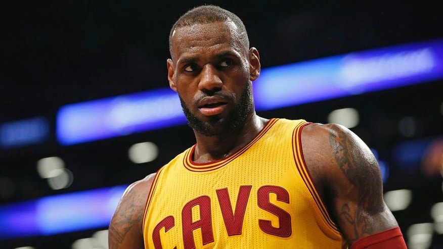 Cleveland Cavaliers forward LeBron James (23) stares down an opponent in the second half of an NBA basketball game, Thursday, March 24, 2016, in New York. The Nets upset the Cavaliers 104-95. (AP Photo/Kathy Willens)