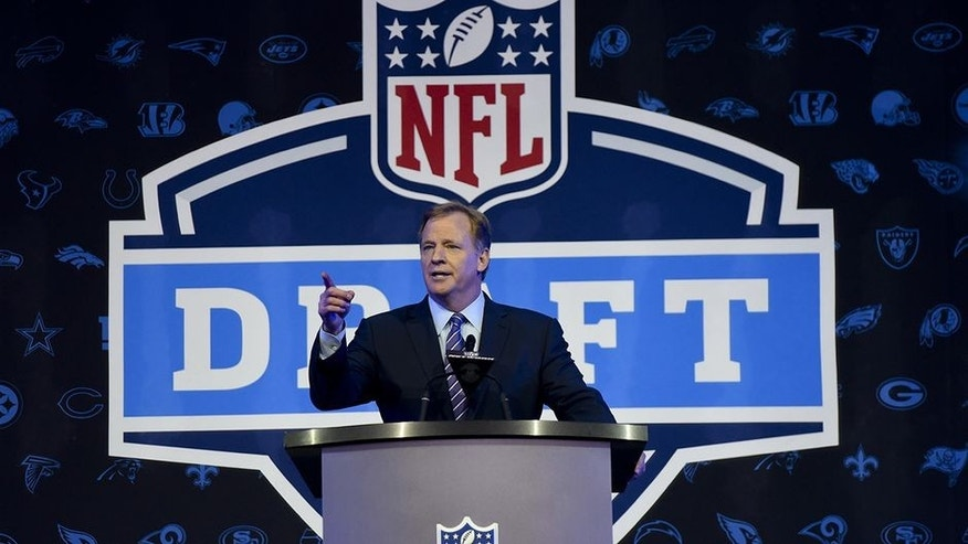 NFL Commissioner Roger Goodell opens up the 2016 NFL football draft at Selection Square in Grant Park, Thursday, April 28, 2016, in Chicago. (AP Photo/Matt Marton)