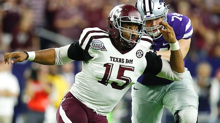 Texas A&M University Aggies defensive lineman Myles Garrett (15) rushes around the edge against Scott Frantz (74) during the Texas Bowl NCAA college football game against the Kansas State University Wildcats on Wednesday, Dec. 28, 2016, in Houston. Kansas State University won 33-28. (Matt Patterson via AP)