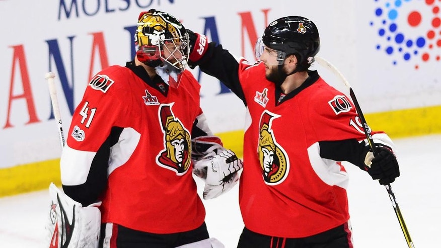 Ottawa Senators goalie Craig Anderson (41) celebrates with center Derick Brassard (19) after the Senators defeated the New York Rangers 2-1 during Game 1 of an NHL hockey second-round playoff series, Thursday, April 27, 2017, in Ottawa, Ontario. (Sean Kilpatrick/The Canadian Press via AP)