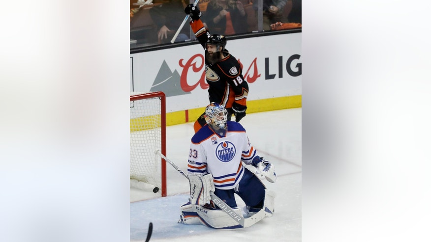 Anaheim Ducks right wing Patrick Eaves, top, celebrates Ryan Getzlaf's goal against Edmonton Oilers goalie Cam Talbot during the second period in Game 1 of a second-round NHL hockey Stanley Cup playoff series in Anaheim, Calif., Wednesday, April 26, 2017. (AP Photo/Chris Carlson)