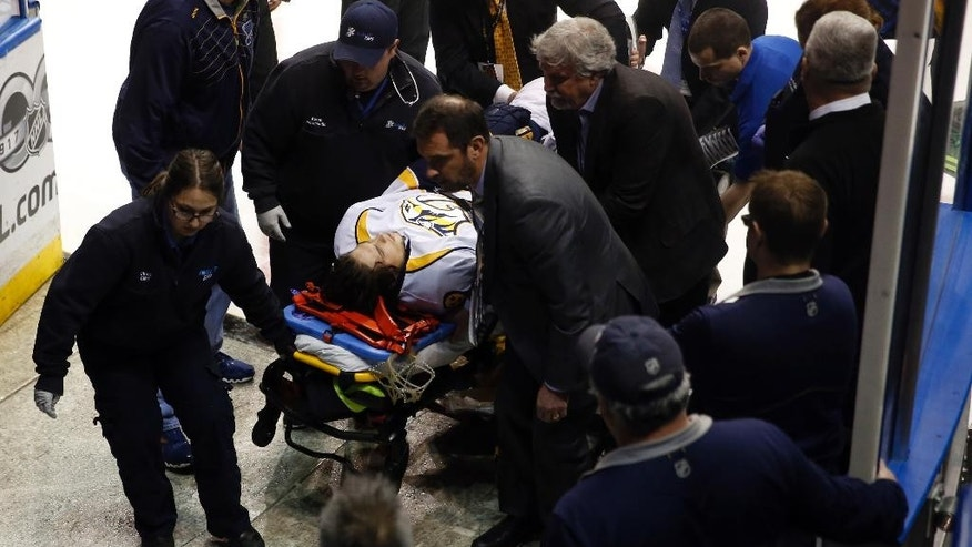 Nashville Predators' Kevin Fiala, of Switzerland, is taken off on a stretcher during the second period in Game 1 of an NHL hockey second-round playoff series against the St. Louis Blues Wednesday, April 26, 2017, in St. Louis. (AP Photo/Jeff Roberson)