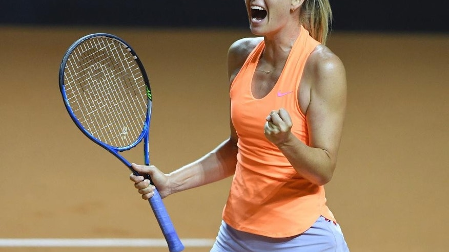 Maria Sharapova reacts during her match against fellow Russian Ekaterina Makarova, at the Porsche Tennis Grand Prix tournament in Stuttgart, Germany, Thursday April 27, 2017.  This is the first professional tennis tournament for Sharapova following a 15-month doping ban.  (Bernd Weissbrod/dpa via AP)