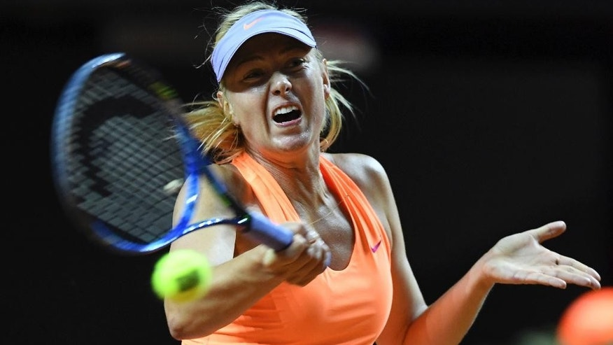 Maria Sharapova returns to fellow Russian Ekaterina Makarova, at the Porsche Tennis Grand Prix tournament in Stuttgart, Germany, Thursday April 27, 2017.  This is the first professional tennis tournament for Sharapova following a 15-month doping ban.  (Bernd Weissbrod/dpa via AP)