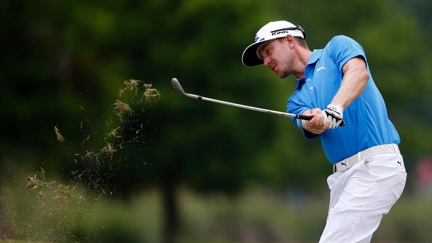 Jonas Blixt, of Sweden, chips onto the eighth green during the second round of the PGA Zurich Classic golf tournament's new two-man team format at TPC Louisiana in Avondale, La., Friday, April 28, 2017. (AP Photo/Gerald Herbert)