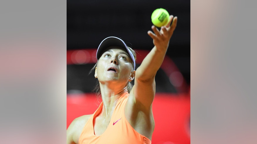 Russia's Maria Sharapova serves to Estonia's Anett Kontaveit during their quarterfinal match at the WTA tennis tournament in Stuttgart, Germany, Friday, April 28, 2017. (Bernd Weissbrod/dpa via AP)