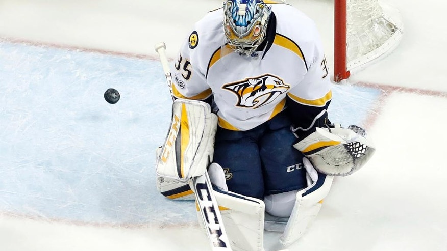 A puck shot by St. Louis Blues' Vladimir Tarasenko, of Russia, slips past Nashville Predators goalie Pekka Rinne, of Finland, for a goal during the third period in Game 2 of an NHL hockey second-round playoff series Friday, April 28, 2017, in St. Louis. The Blues won 3-2. (AP Photo/Jeff Roberson)
