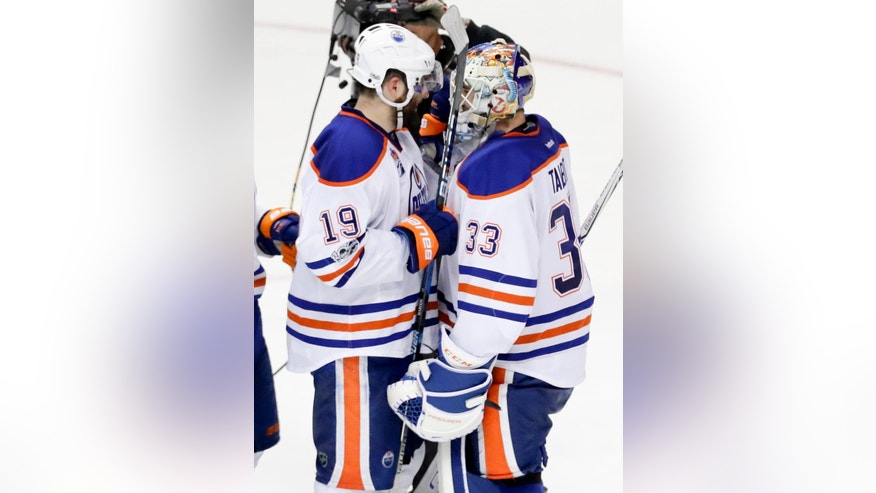 Edmonton Oilers goalie Cam Talbot, right, and Patrick Maroon celebrates after their 2-1 win against the Anaheim Ducks in Game 2 of a second-round NHL hockey Stanley Cup playoff series in Anaheim, Calif., Friday, April 28, 2017. The Oilers won 5-3. (AP Photo/Chris Carlson)