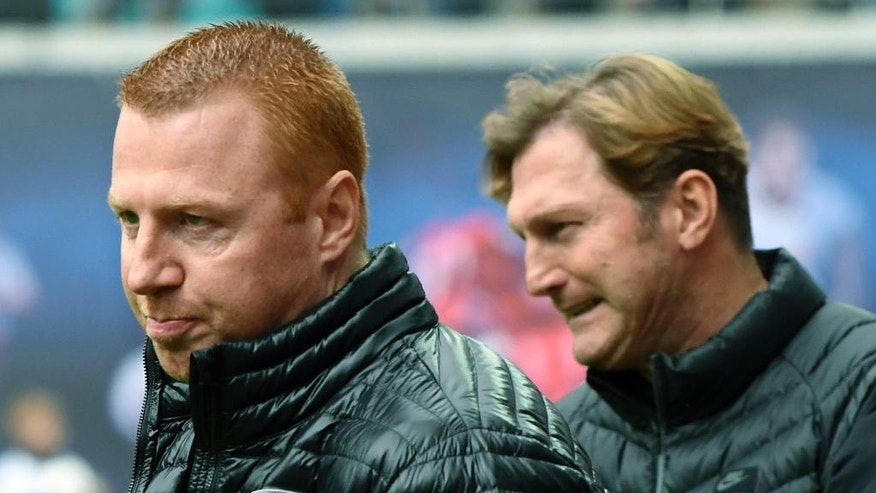 Ingolstadt's head coach Maik Walpurgis, left, waits besides Leipzig's head coach Ralph Hasenhuettl, right, prior to the German first division Bundesliga soccer match between RB Leipzig and FC Ingolstadt 04 in Leipzig, Germany, Saturday, April 29, 2017. (AP Photo/Jens Meyer)