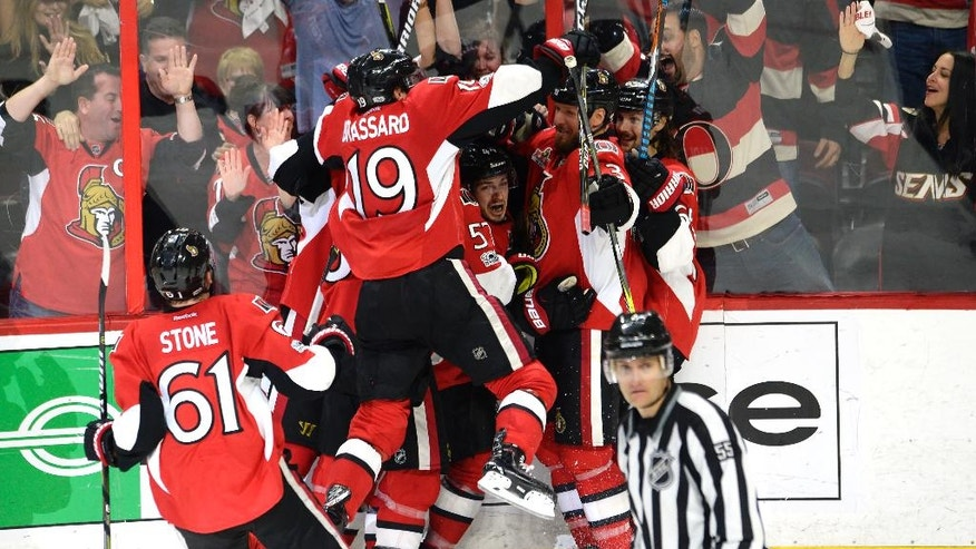 Ottawa Senators center Jean-Gabriel Pageau (44) celebrates his game-winning goal against the New York Rangers during the second overtime of Game 2 of an NHL hockey Stanley Cup second-round playoff series Saturday, April 29, 2017, in Ottawa, Ontario. The Senators won 6-5. (Adrian Wyld/The Canadian Press via AP)