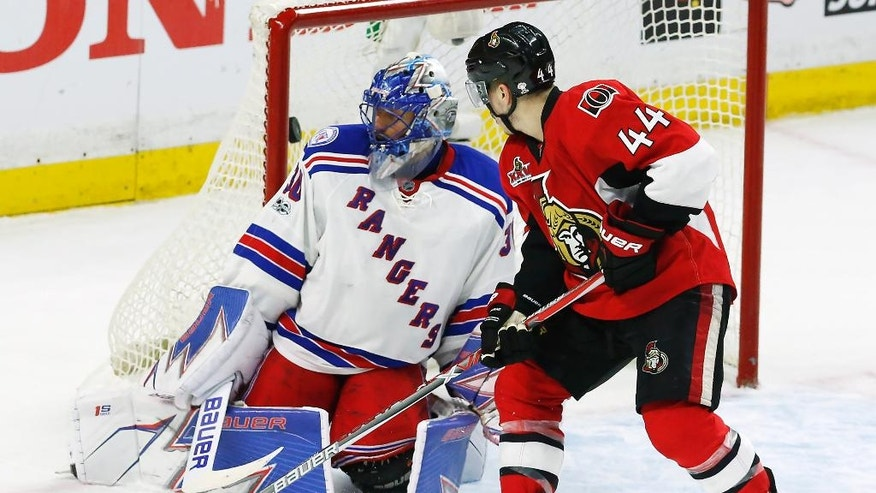 Ottawa Senators center Jean-Gabriel Pageau (44) scores his third goal of the day against New York Rangers goalie Henrik Lundqvist (30) during the third period of Game 2 of an NHL hockey Stanley Cup second-round playoff series Saturday, April 29, 2017, in Ottawa, Ontario. (Fred Chartrand/The Canadian Press via AP)