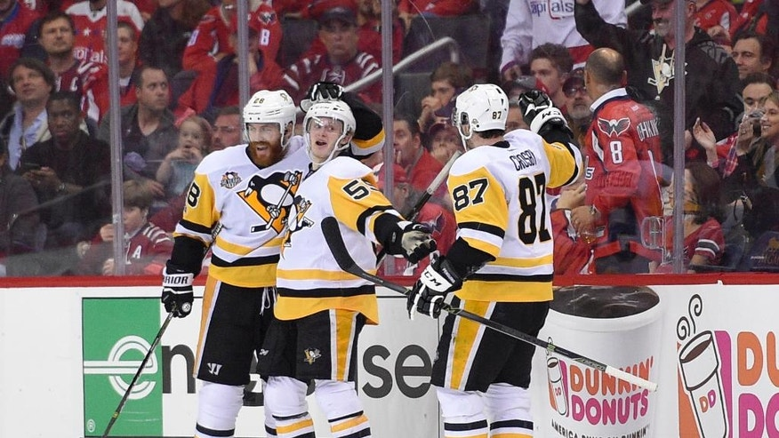 Pittsburgh Penguins center Jake Guentzel, center, celebrates his goal with Sidney Crosby (87) and Ian Cole (28) during the second period of Game 2 in an NHL hockey Stanley Cup second-round playoff series against the Washington Capitals, Saturday, April 29, 2017, in Washington. (AP Photo/Nick Wass)