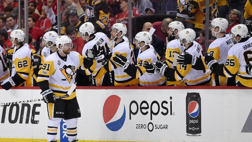 Pittsburgh Penguins right wing Phil Kessel (81) celebrates his goal during the second period of Game 2 in an NHL hockey Stanley Cup second-round playoff series against the Washington Capitals, Saturday, April 29, 2017, in Washington. (AP Photo/Nick Wass)