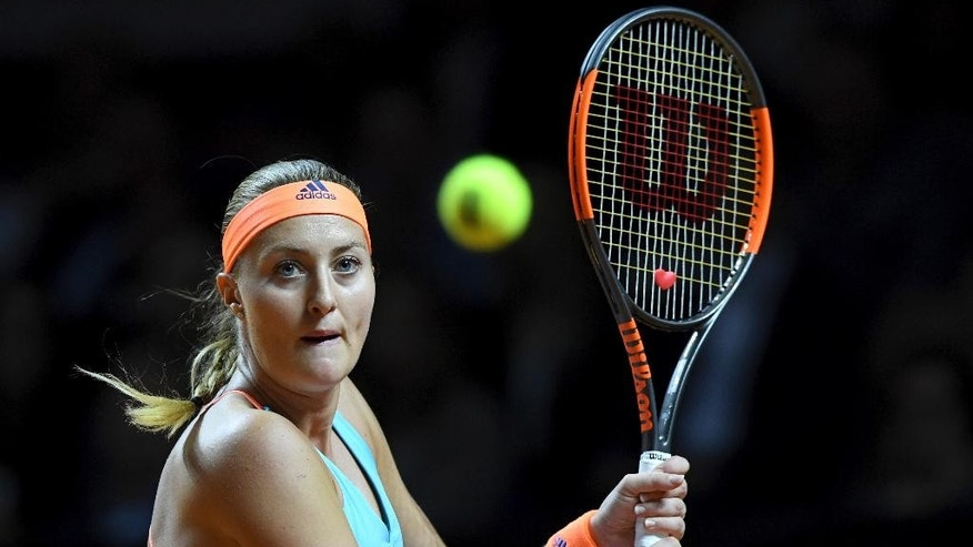 Kristina Mladenovic of France returns the ball to Germany's Laura Siegemund during the final of the Porsche Grand Prix tennis tournament in Stuttgart, Germany Sunday, April 30, 2017. (Bernd Weissbrod/dpa via AP)