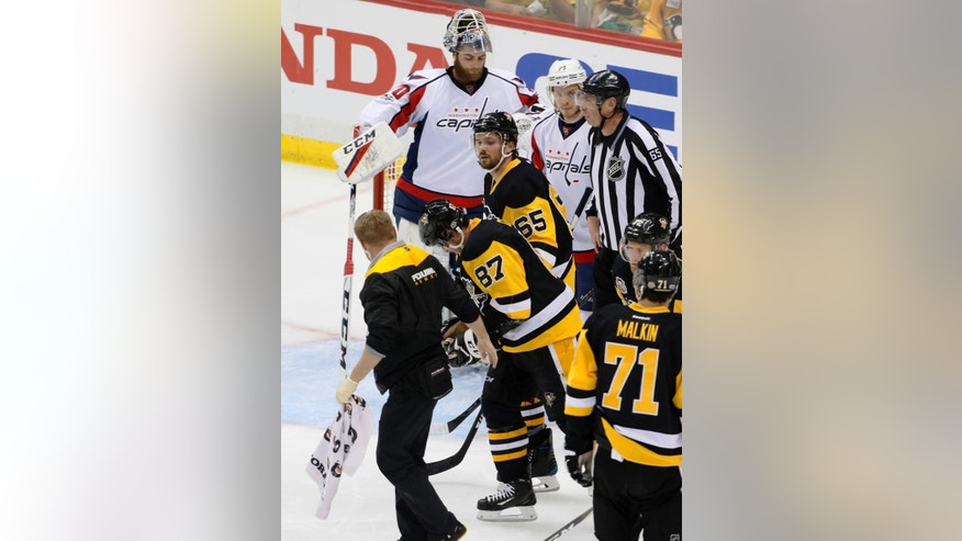 Pittsburgh Penguins' Sidney Crosby (87) is helped off the ice after being injured during the first period of Game 3 in an NHL Stanley Cup Eastern Conference semifinal hockey game against the Washington Capitals in Pittsburgh, Monday, May 1, 2017. (AP Photo/Gene J. Puskar)