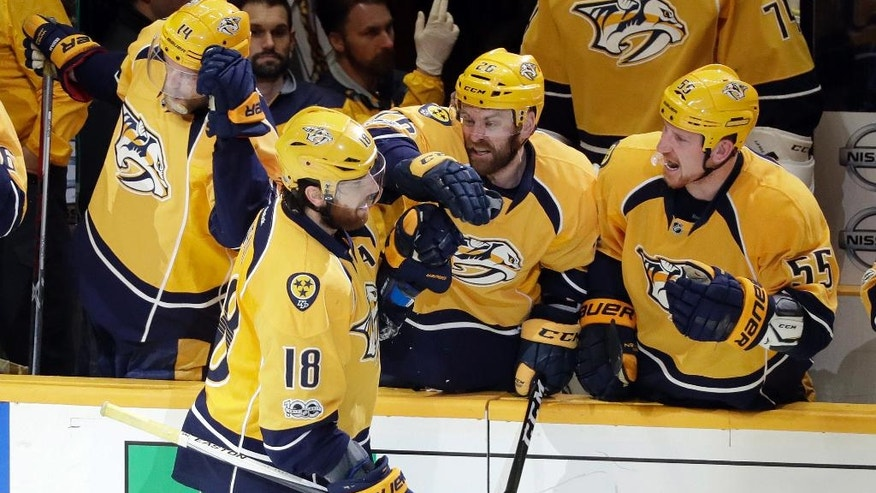 Nashville Predators right wing James Neal (18) is congratulated after scoring a goal against the St. Louis Blues during the third period in Game 4 of a second-round NHL hockey playoff series Tuesday, May 2, 2017, in Nashville, Tenn. (AP Photo/Mark Humphrey)