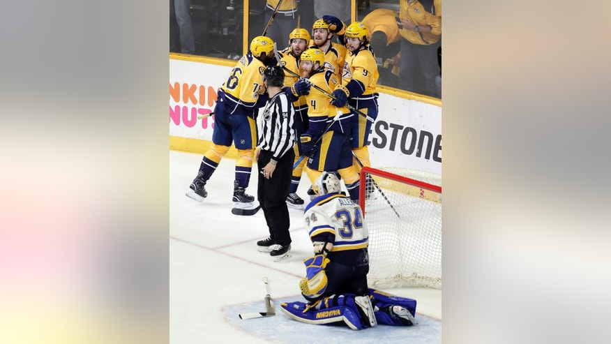 Nashville Predators defenseman Ryan Ellis (4) celebrates with teammates after he scored a goal against St. Louis Blues goalie Jake Allen (34) during the third period in Game 4 of a second-round NHL hockey playoff series Tuesday, May 2, 2017, in Nashville, Tenn. (AP Photo/Mark Humphrey)
