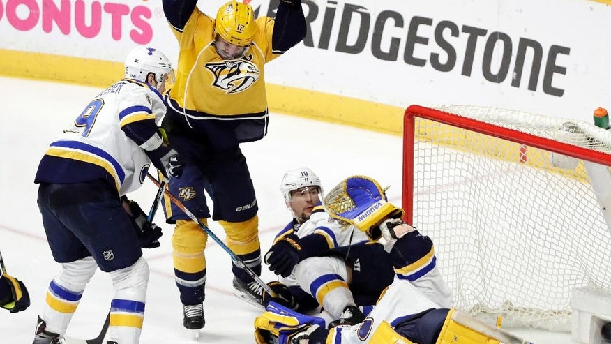 Nashville Predators center Mike Fisher (12) celebrates after teammate Ryan Ellis scored a goal against St. Louis Blues goalie Jake Allen during the third period in Game 4 of a second-round NHL hockey playoff series Tuesday, May 2, 2017, in Nashville, Tenn. (AP Photo/Mark Humphrey)