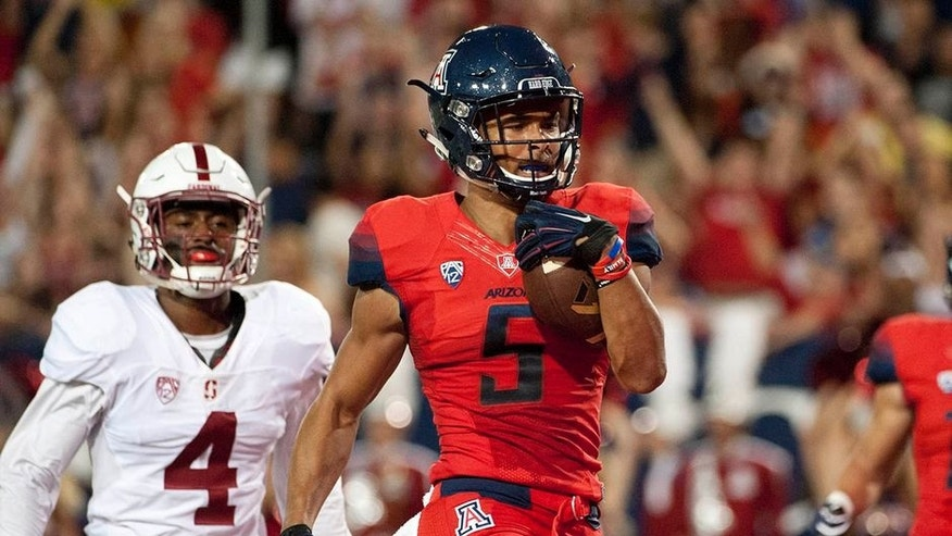 Oct 29, 2016; Tucson, AZ, USA; Arizona Wildcats wide receiver Trey Griffey (5) runs the ball for a touchdown under pressure from Stanford Cardinal cornerback Frank Buncom (4) during the second quarter at Arizona Stadium. Mandatory Credit: Casey Sapio-USA TODAY Sports