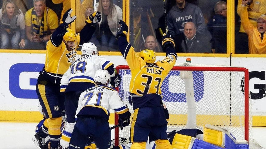 Nashville Predators center Mike Fisher, left, and left wing Colin Wilson (33) celebrate after teammate Ryan Ellis, not seen, scored a goal against St. Louis Blues goalie Jake Allen during the third period in Game 4 of a second-round NHL hockey playoff series Tuesday, May 2, 2017, in Nashville, Tenn. The Predators won 2-1 to take a 3-1 lead in the series. (AP Photo/Mark Humphrey)