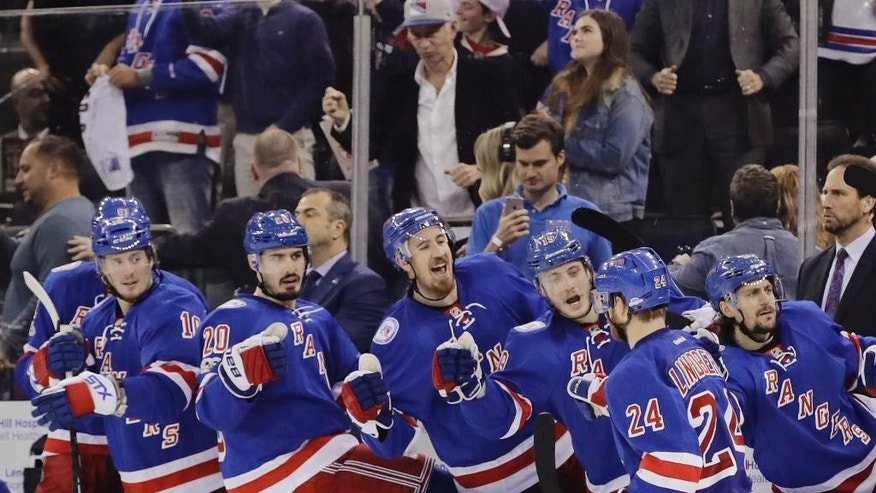 New York Rangers center Oscar Lindberg (24) celebrates with teammates after scoring a goal during the second period of Game 4 of an NHL hockey Stanley Cup second-round playoff series against the Ottawa Senators Thursday, May 4, 2017, in New York. (AP Photo/Frank Franklin II)