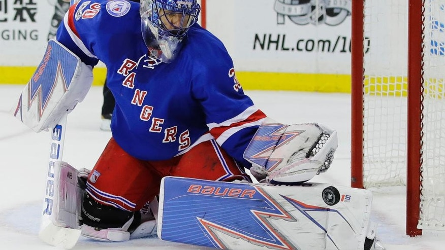 New York Rangers goalie Henrik Lundqvist, of Sweden, stops a shot on the goal during the first period of Game 4 of an NHL hockey Stanley Cup second-round playoff series against the Ottawa Senators Thursday, May 4, 2017, in New York. (AP Photo/Frank Franklin II)