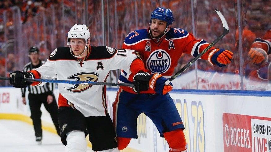 Anaheim Ducks' Corey Perry, left, checks Edmonton Oilers' Milan Lucic during the second period of Game 4 of an NHL hockey second-round playoff series, Wednesday, May 3, 2017, in Edmonton, Alberta. (Jeff McIntosh/The Canadian Press via AP)