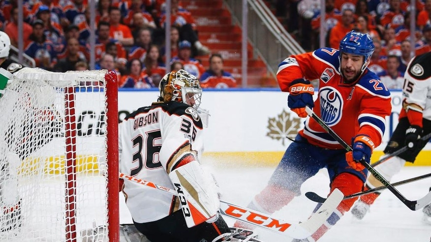 Anaheim Ducks goalie John Gibson, left, blocks the net as Edmonton Oilers' Milan Lucic closes in during the second period of Game 4 of an NHL hockey second-round playoff series, Wednesday, May 3, 2017, in Edmonton, Alberta. (Jeff McIntosh/The Canadian Press via AP)